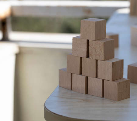 Building from wooden cubes and rods. A photo was taken on the desk. Banco de Imagens