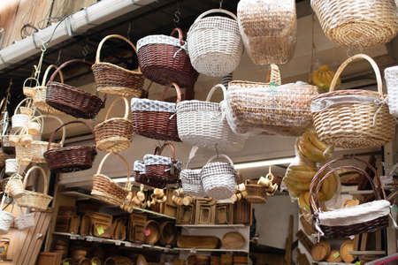 Handmade baskets are available in many different types and patterns. Photographed in front of the store.