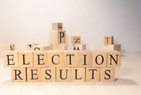 Electoral results The word is from wooden cubes. Economy state government terms. Background made of wooden letters.