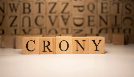 The word crony was created from wooden cubes. Countries and politics, people. close up.