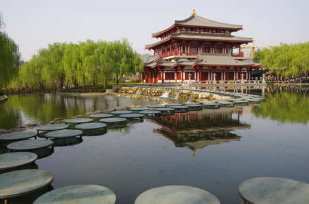 tourist spot: Asia China xi  an datang lotus park lake Chinese traditional architectural landscape ancient bridge ancient archaize building tourist spot reflection lake at night
