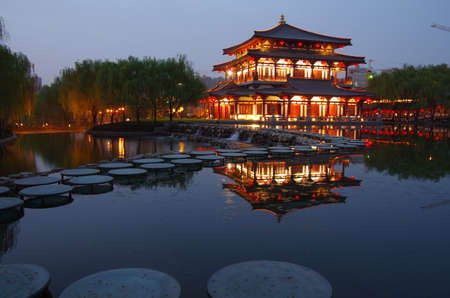 Asia China xi  an datang lotus park lake Chinese traditional architectural landscape ancient bridge ancient archaize building tourist spot reflection lake at night