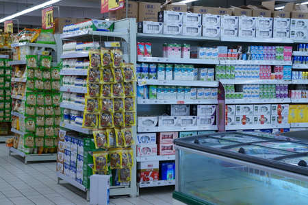 purchasing power: On October 2, 2011, xi an supermarket shelves display all kinds of goods, customers in the choose and buy.
