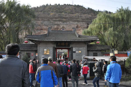 Tourists entering a chinese temple