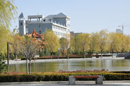 View of beautiful park with lake in a city 版權商用圖片