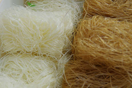 Close-up of various types of raw rice noodles