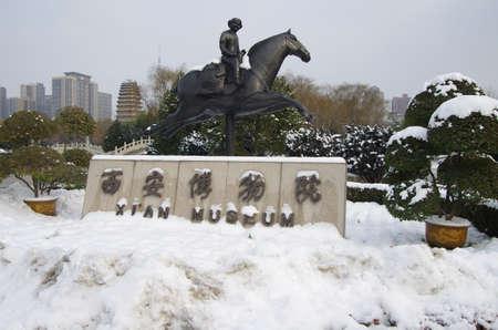 Sculpture of a man riding a horse at Xian museum