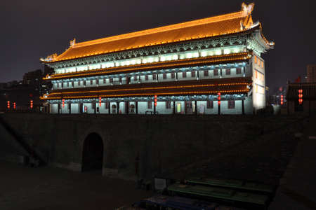 The city wall of xi an at night is a famous scenic spot of ancient architecture. 新聞圖片
