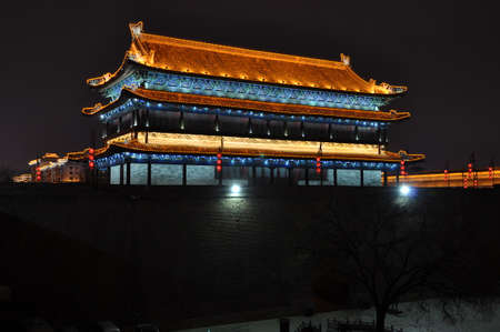 The city wall of xi an at night is a famous scenic spot of ancient architecture. Editorial