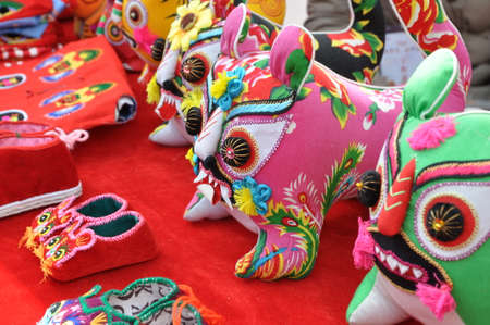 Handicraft tiger shoes. A traditional pair of shoes.