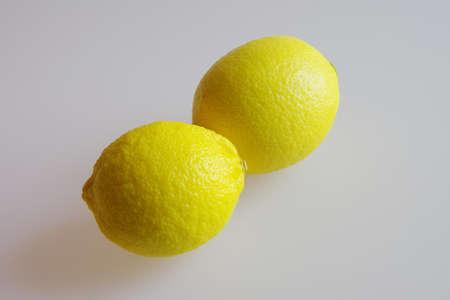 Lemons on a plain surface