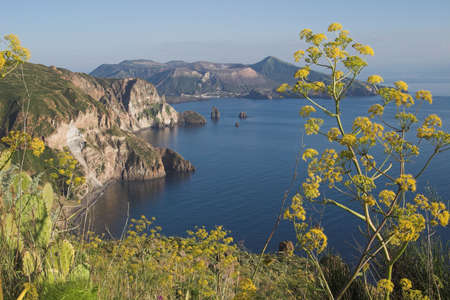 vulcano: Quattrocchi is one of the nicest views on the Isle of Lipari. In the Distance the Isle of vulcano with its crater. A few smoke coming out.