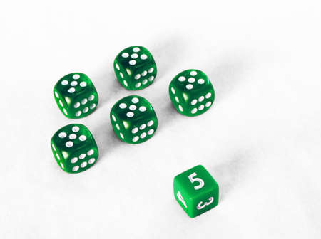 squelch: Dice game - Platoon of green fives Stock Photo