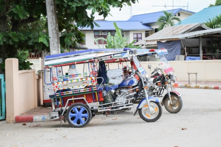 antique tricycle: Motor tricycle thaistyle in olded city of thailand