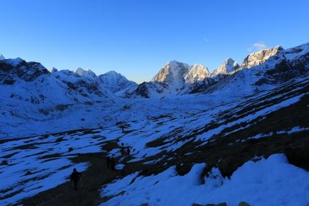 trekker lobuche summit beside of everest from kallapather summit nepal photo