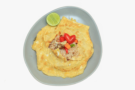 carot: flavored fried rice in an omelet wrapping