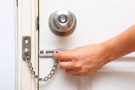 protect home: chain lock and knob lock in door for protect home