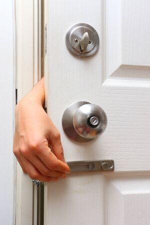 protect home: bandit hand chain lock and knob lock in door for protect home Stock Photo