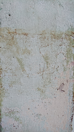 house flood: dirty colour paint on wall after flood in house