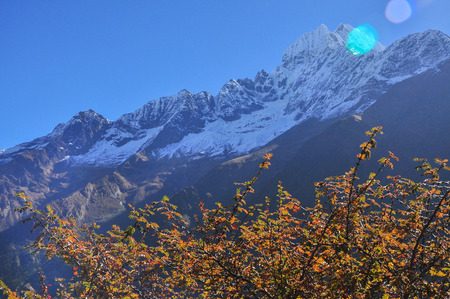 sulight: Amadablam and sulight flare from Mount Everest trek Stock Photo