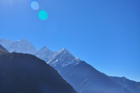 sulight: lobche and sulight flare from everest trek