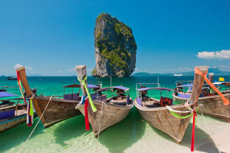 Beautiful Beach   Longtail Boats at Krabi, Thailand photo