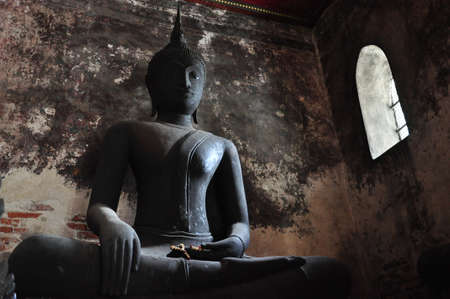 Ancient Buddha in Wat Suthat Temple, Bangkok, Thailand photo