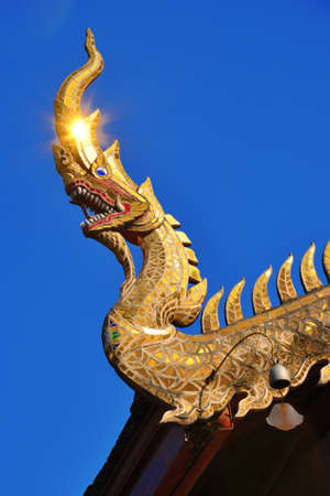 Naga with sparkling gold, Thailand photo