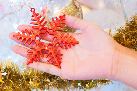Red snow flake on hand - Christmas decoration