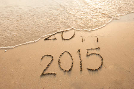 Year 2015 Coming written on the beach photo