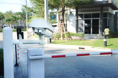 entrances: Villa surveillance camera or cctv stand on entrance and exit for security Stock Photo