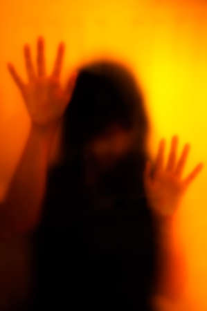 abducted: Woman behind the matte glass. Blurry hand and body figure abstraction.