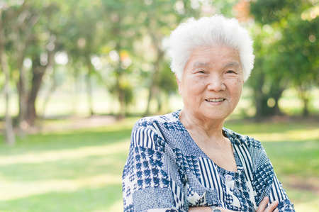 elderly: Portrait of a smiling elderly woman in public park