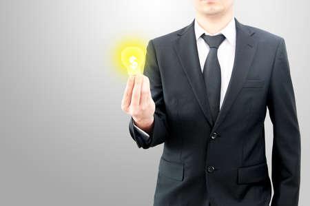 Businessman hold money dollar sign in bulb on hand creative business idea concept