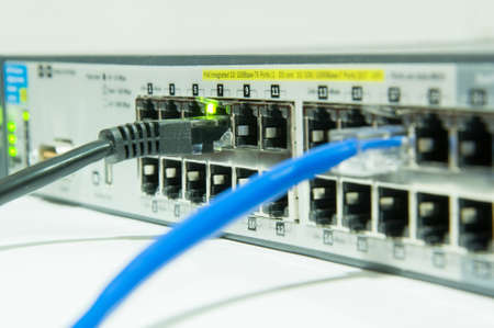 utp: internet network switch with UTP cable isolated on the white