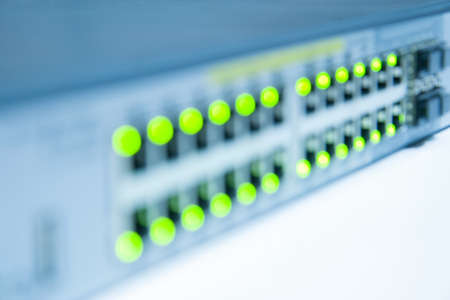 Blurred internet network switch with LED flashing isolated on white background