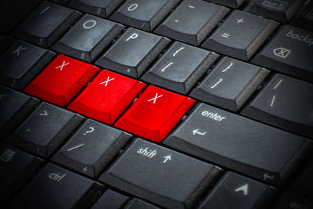 adult sex: Red button Keywords xxx on keyboard computer, Adult sex online concept Stock Photo