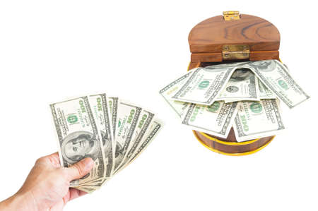 avidity: Saving concept : Money dollars in hand collect in wooden chest Stock Photo