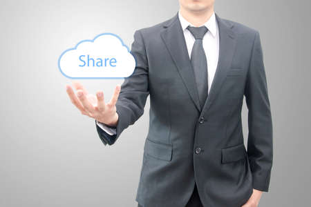 cloud network: Cloud share concept on hand of a businessman in suit