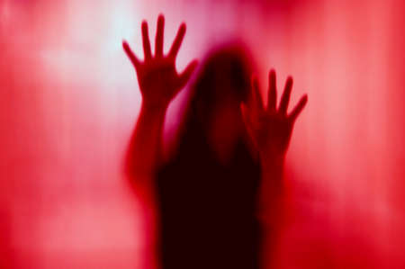 Woman behind the matte glass. Blurry hand and body figure abstraction.
