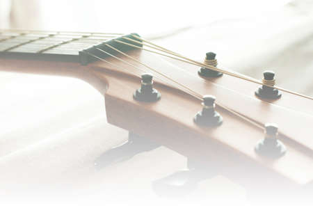 middle joint: Guitar with depth of field in soft light Stock Photo