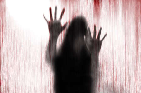 people shadow: Horror woman behind the matte glass blood stain.  Blurry hand and body figure abstraction. Stock Photo