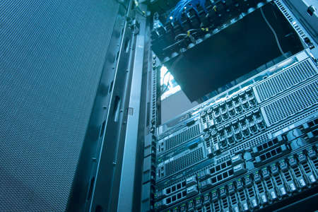 server hardware: Server and array disk storage in data center with depth of field in cool tone