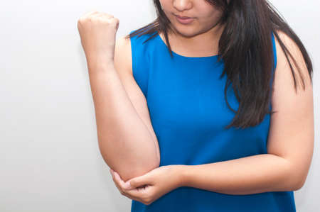 elbow pain: Young woman with elbow pain