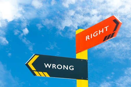 wrong: Direction signage right or wrong dilemma concept Stock Photo