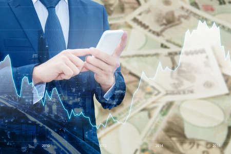 Double exposure of businessman , Financial graph and cityscape with Japanese JPY Yen bank note pile background, Business and finance concept Standard-Bild