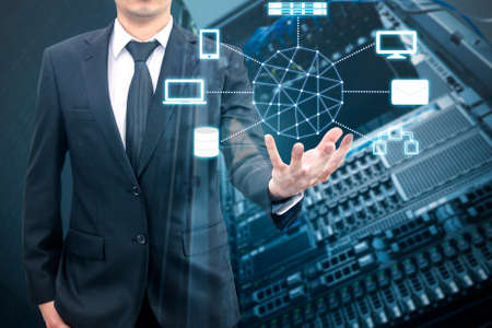 Double expoure of professional businessman connecting cloud technology on hand with cloud and sky in Technology, Communication and business concept Standard-Bild