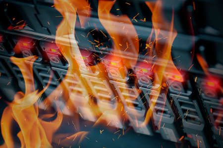 data recovery: Disaster in data center room server and storage on fire burning