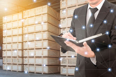 international internet: Businessman analyzing report with blurred transport cargo logistic distribution background , network line connection in communication, transportation and business concept Stock Photo