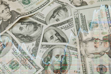 Dollar notes pile with graph and currency exchange rate on digital LED display board